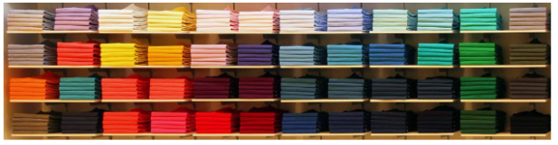 Stacks-of-t-shirts-on-shelves.png